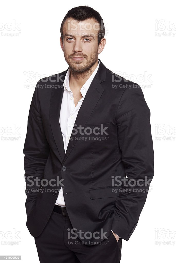 Relaxed fashionable man in suit standing casually stock photo