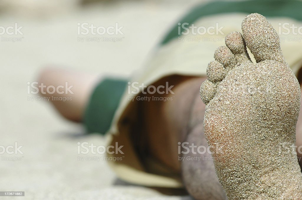 relaxed feet at the beach royalty-free stock photo
