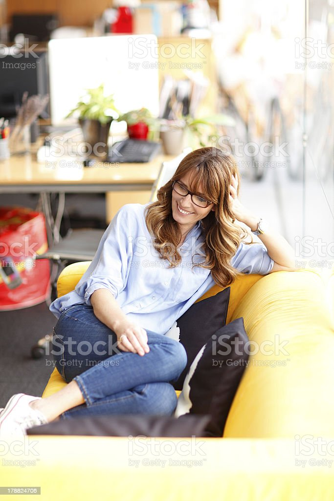 Relaxed female executive in office royalty-free stock photo