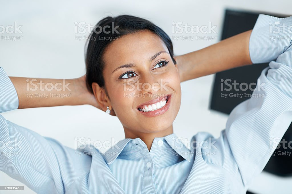 Relaxed female executive stock photo