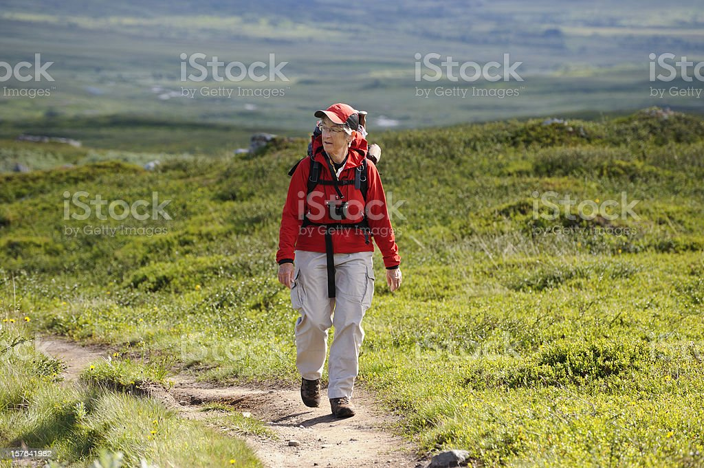 Relaxed female hiker with backpack stock photo