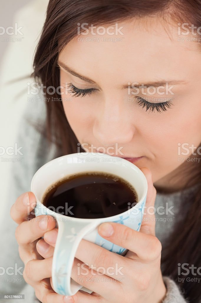 Relaxed girl drinking a cup of coffee royalty-free stock photo
