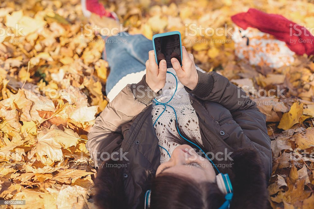 Relaxed girl texting among nature stock photo