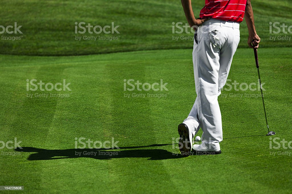relaxed golfer stock photo