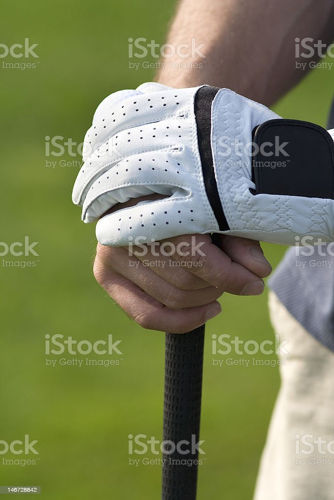 Relaxed hands on golf club - Vertical stock photo