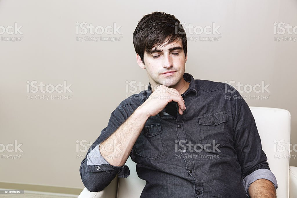 relaxed handsome young man royalty-free stock photo