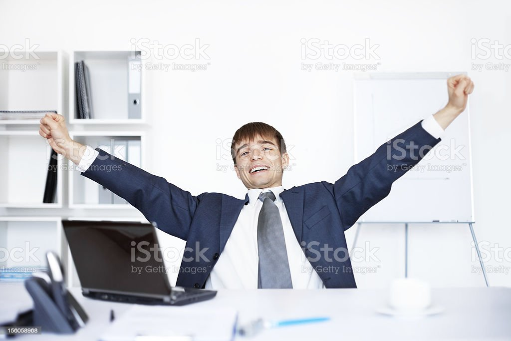Relaxed happy young business man after working at the office royalty-free stock photo