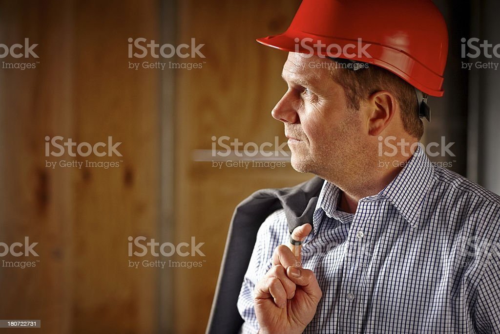 Relaxed male engineer at work site royalty-free stock photo