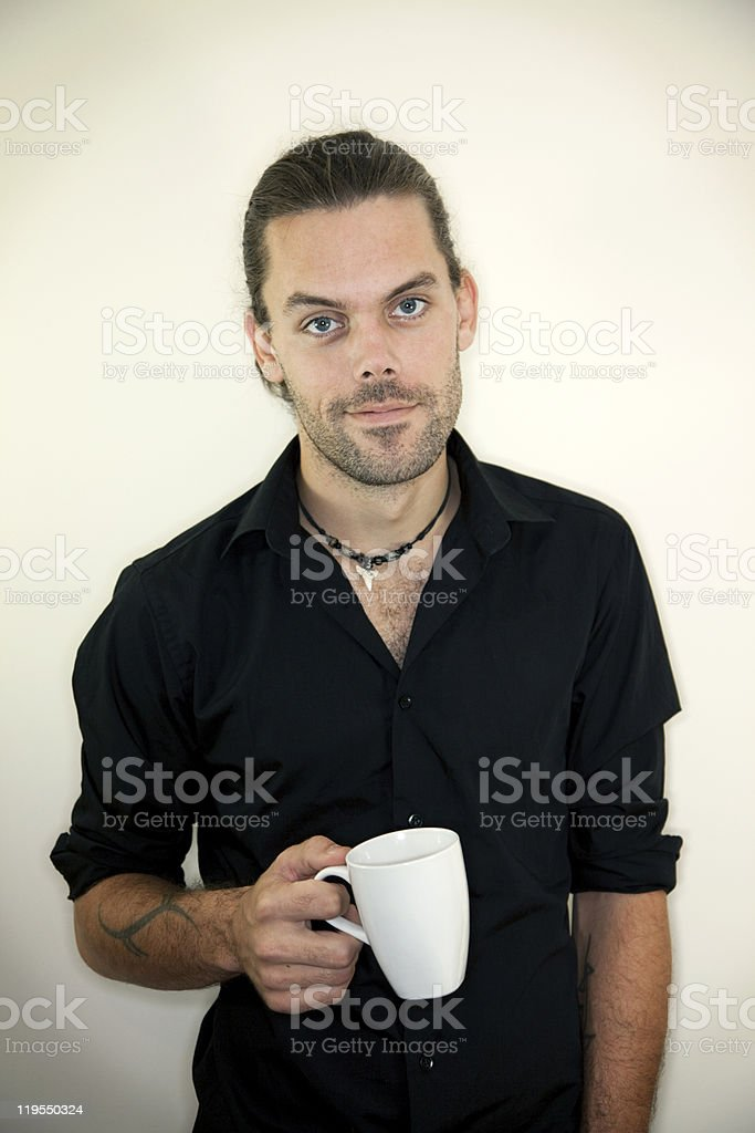 Relaxed man drinks coffee stock photo