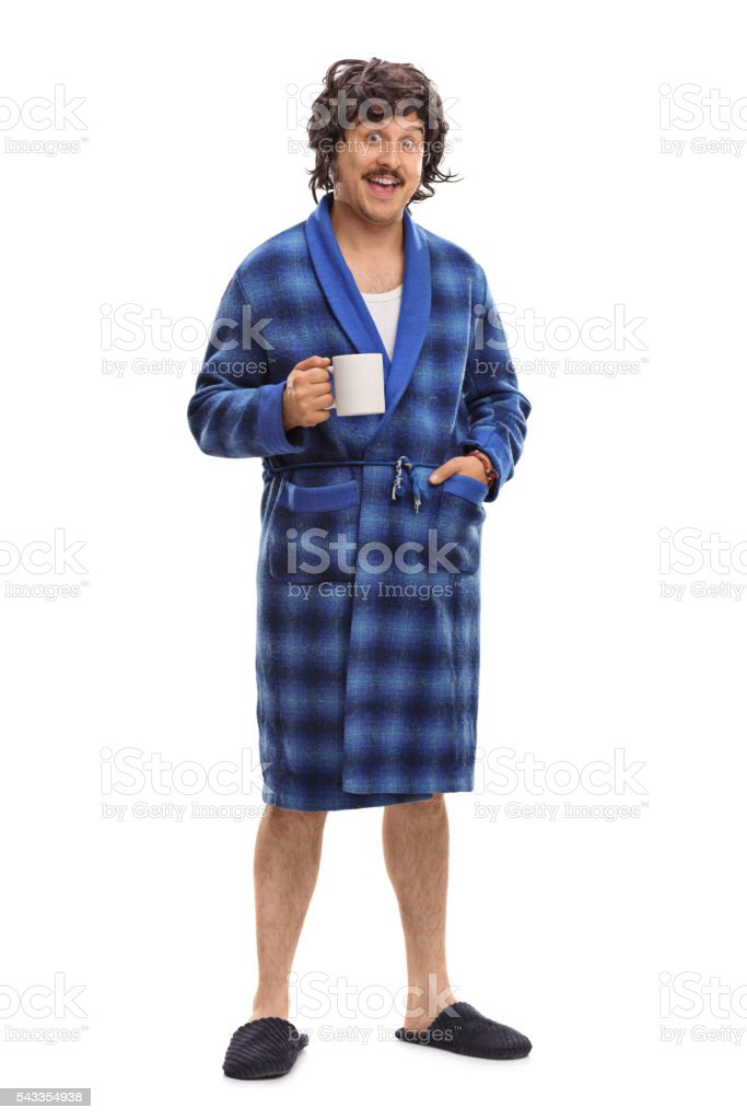 Relaxed man holding a cup of coffee stock photo