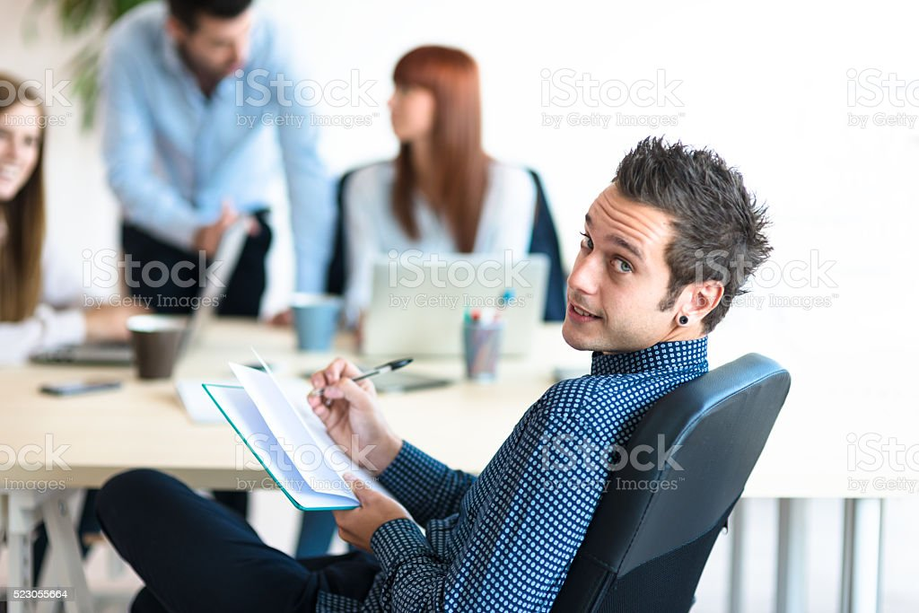 relaxed man in the office stock photo