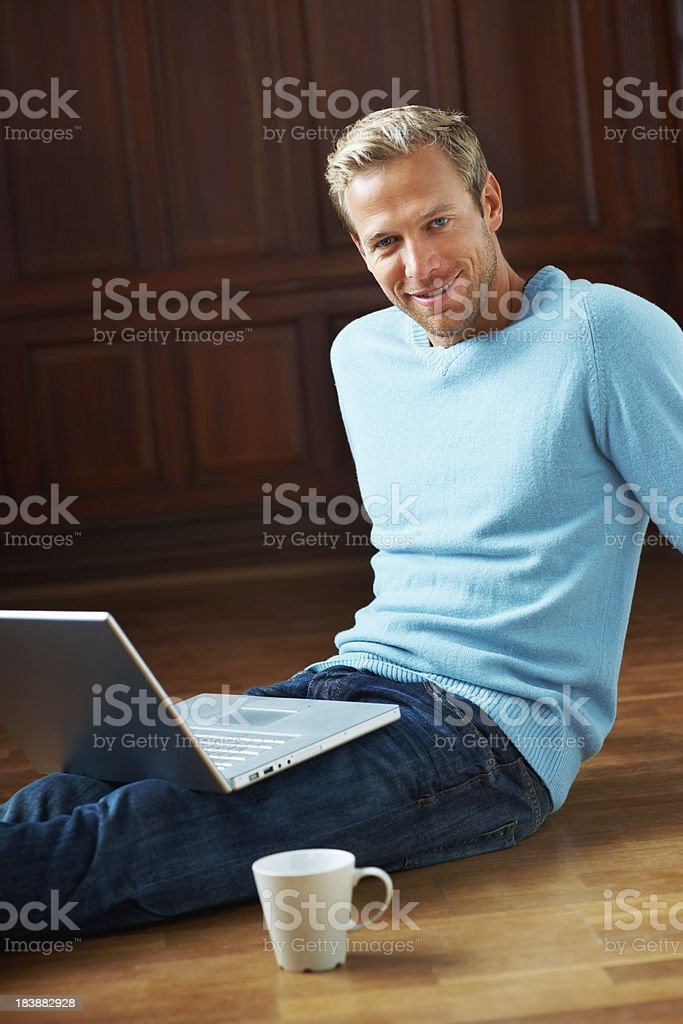 Relaxed man with a laptop and coffee cup royalty-free stock photo