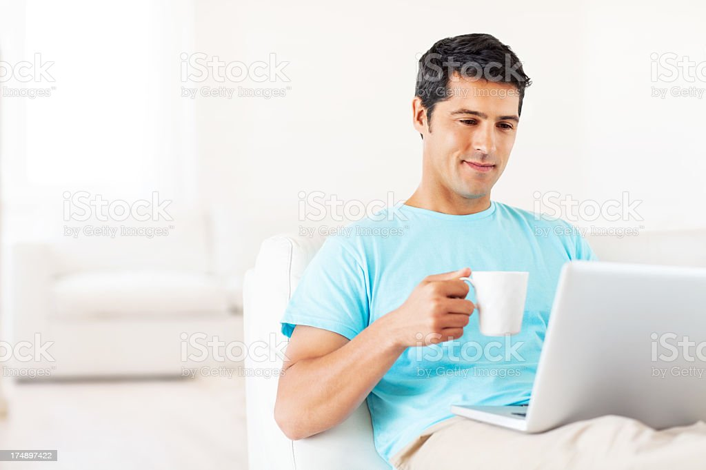 Relaxed Man With Laptop Having Coffee royalty-free stock photo