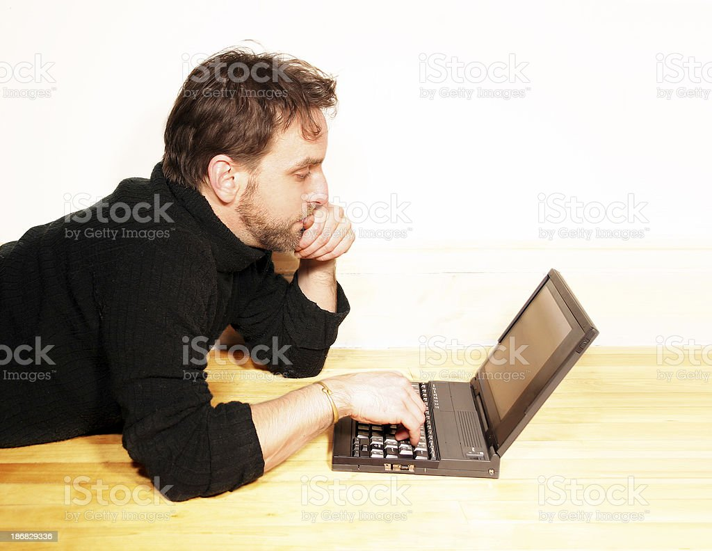 Relaxed man working on his laptop royalty-free stock photo
