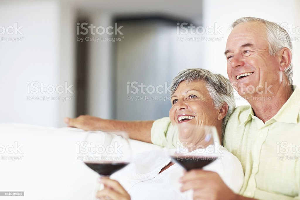 Relaxed mature couple drinking wine royalty-free stock photo
