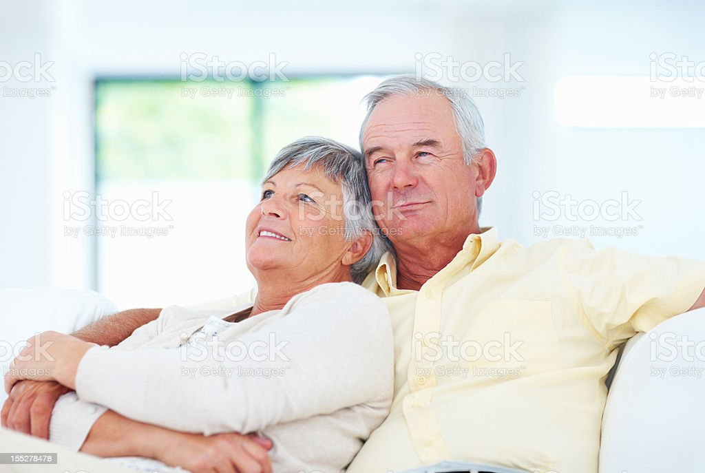 Relaxed mature couple on couch royalty-free stock photo