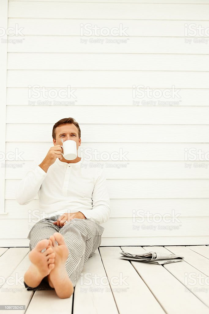 Relaxed mature man drinking coffee outdoors royalty-free stock photo