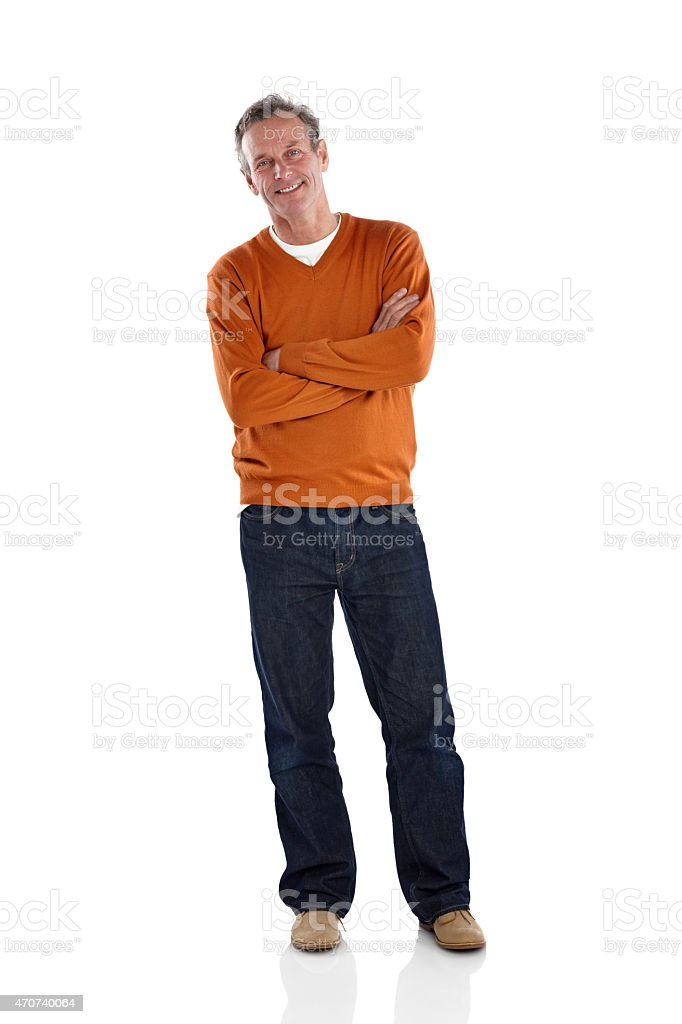 Relaxed mature man standing with his arms crossed stock photo