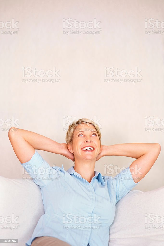 Relaxed mature woman smiling to copyspace royalty-free stock photo