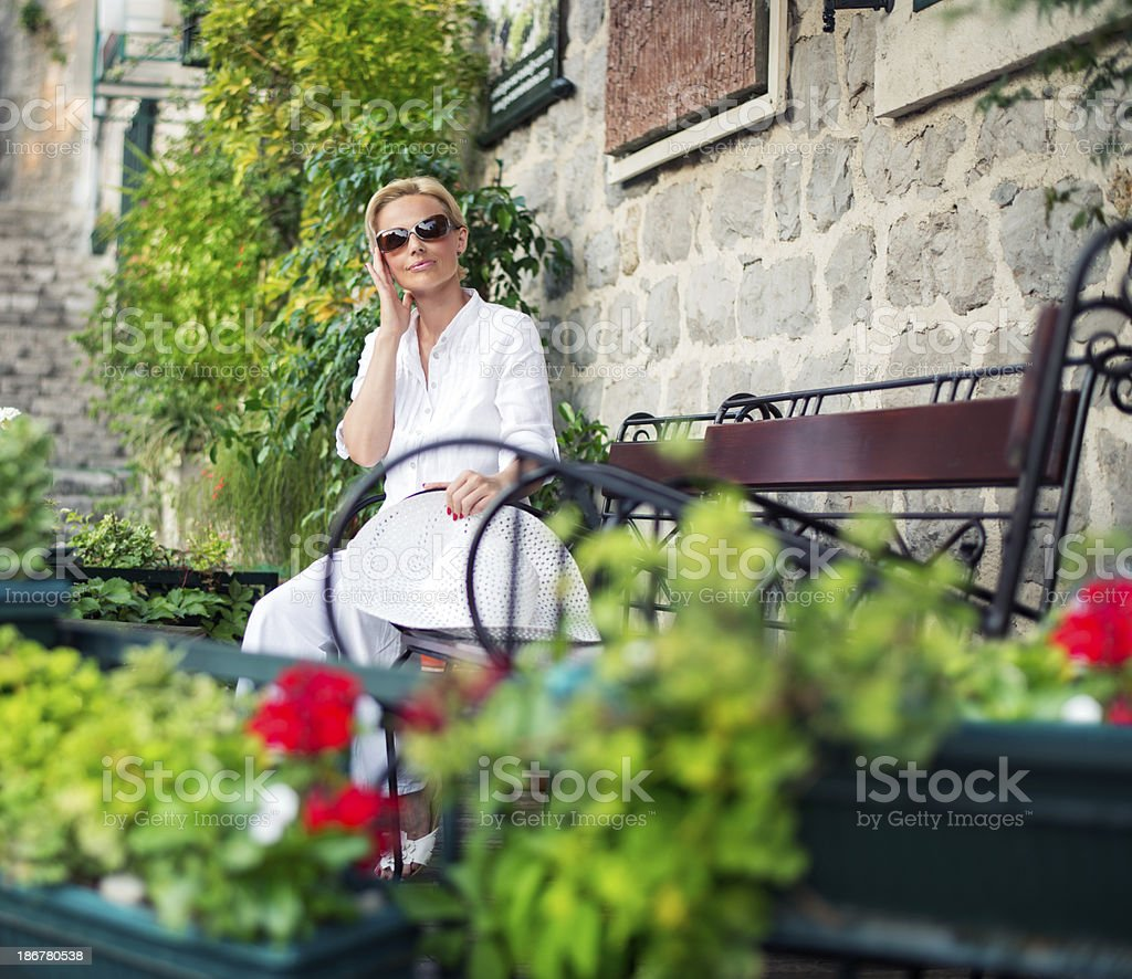 Relaxed mid adult woman stock photo