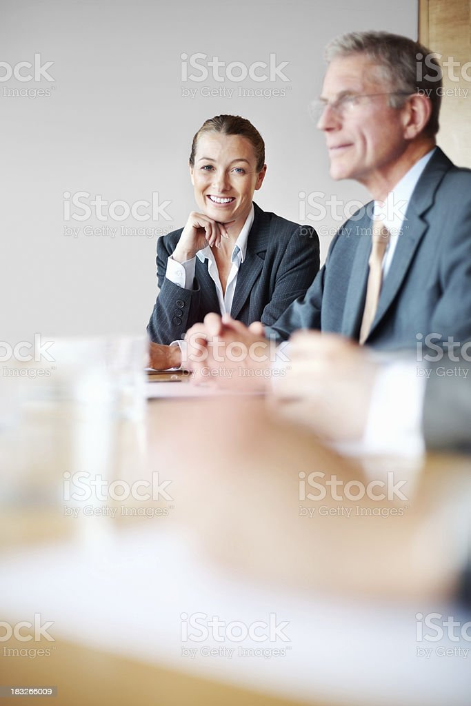 Relaxed middle aged business woman with her colleague in meeting royalty-free stock photo