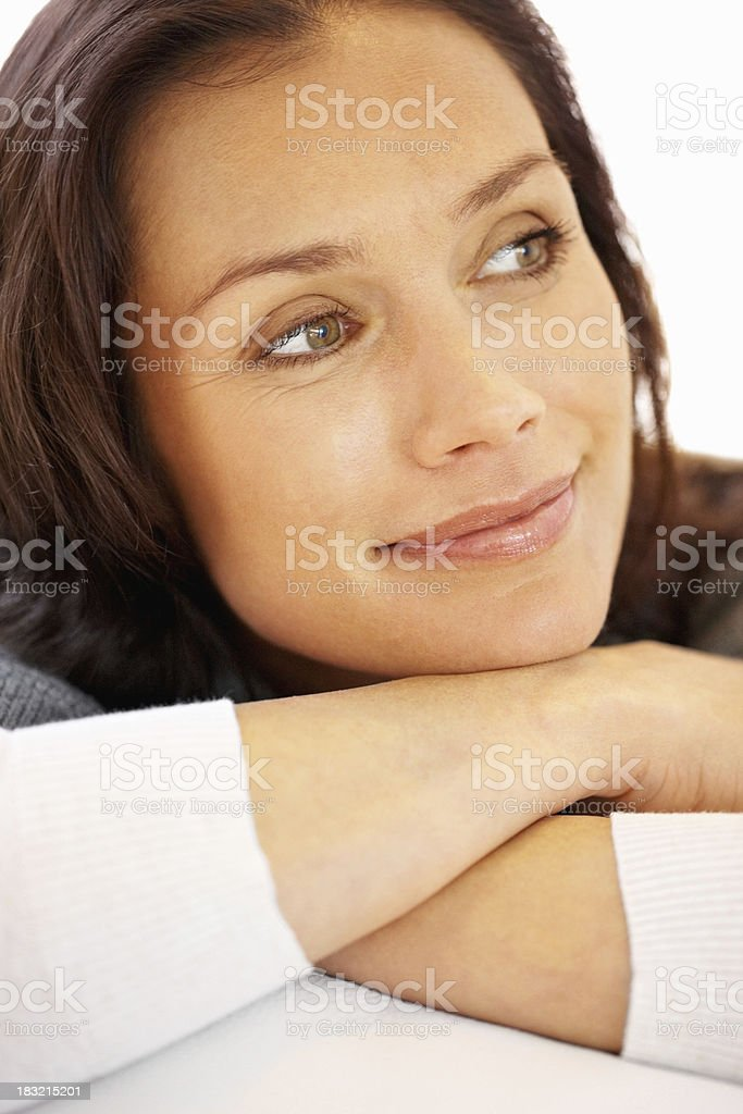 Relaxed middle aged female smiling while looking away royalty-free stock photo