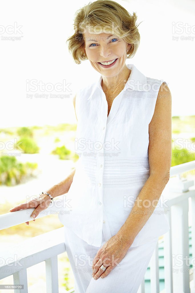 Relaxed older woman on a porch royalty-free stock photo