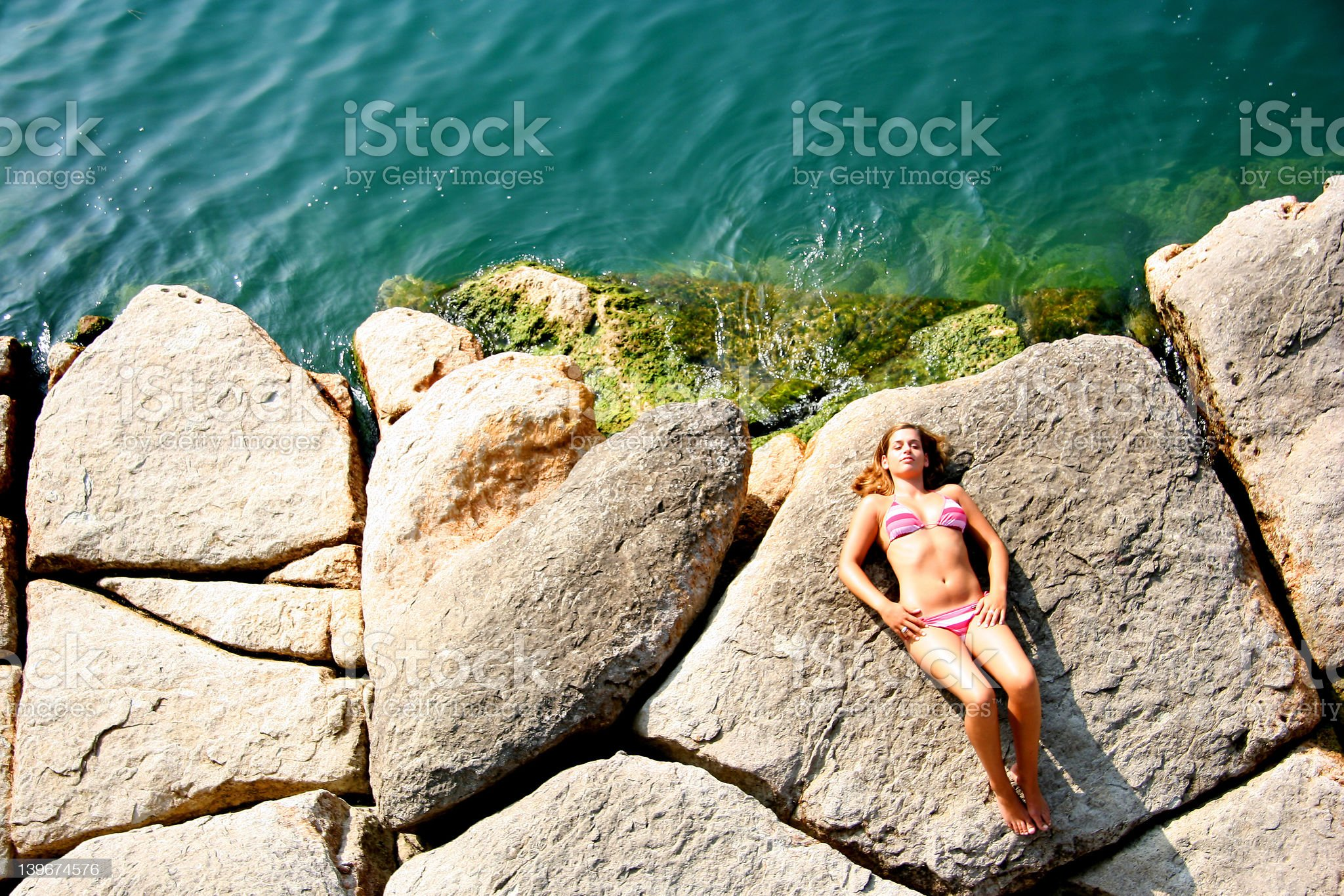 Relaxed on a lake shore royalty-free stock photo
