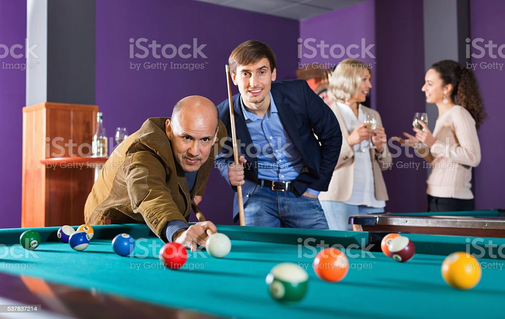 Relaxed  people playing billiard and darts stock photo