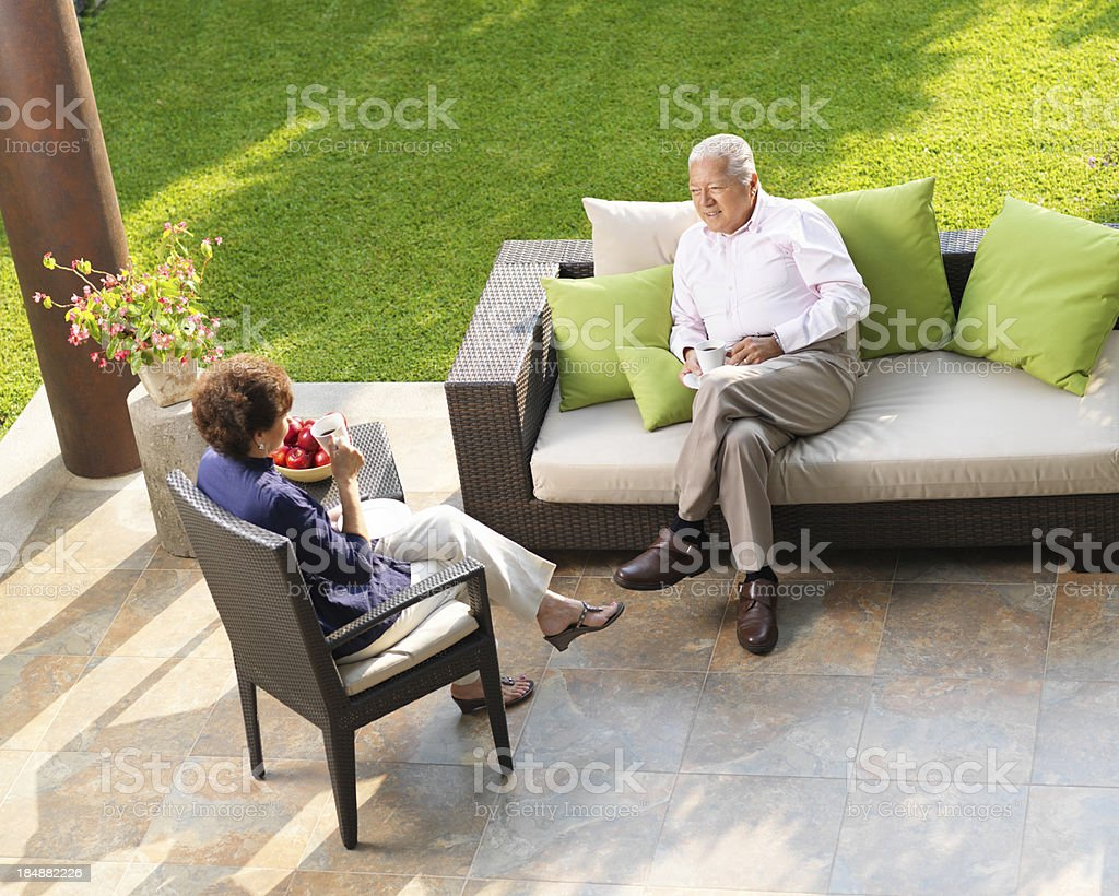 Relaxed senior couple drinking coffee royalty-free stock photo