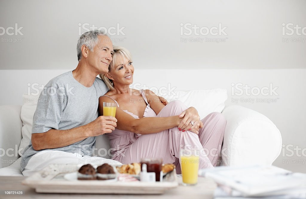 Relaxed senior couple having their breakfast at home royalty-free stock photo
