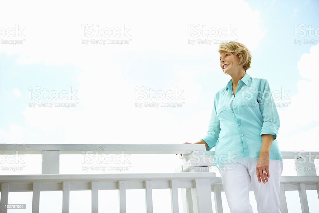 Relaxed senior woman on porch royalty-free stock photo