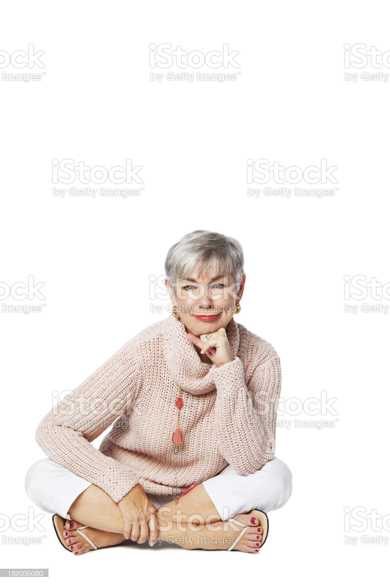 Relaxed Senior Woman Sitting On Floor royalty-free stock photo