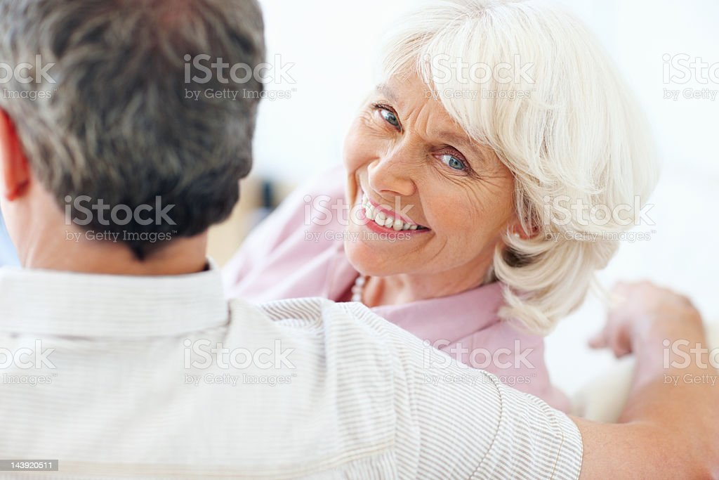 Relaxed senior woman with man royalty-free stock photo