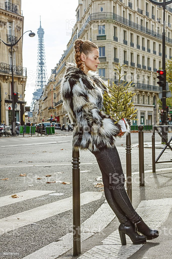 relaxed trendy woman with Christmas tree in Paris, France stock photo