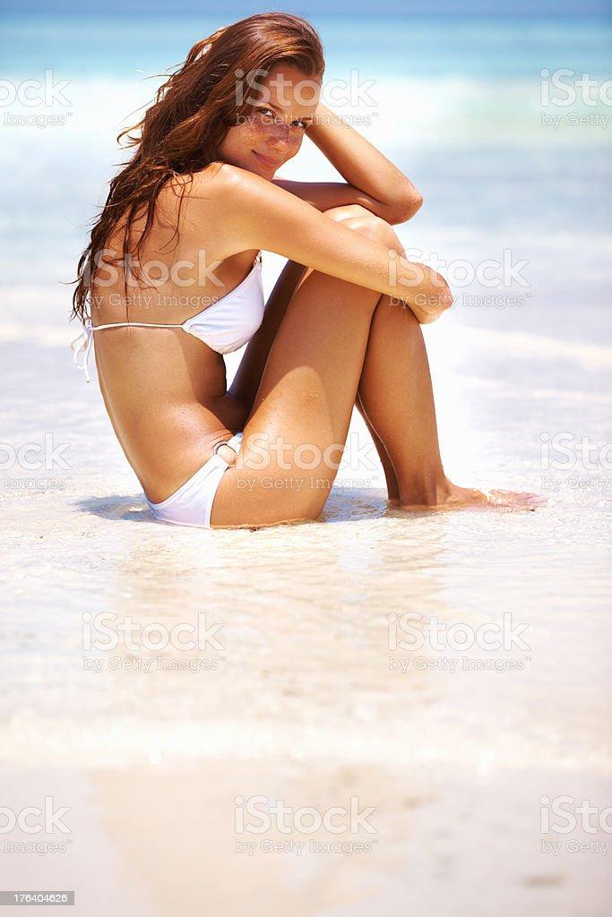 Relaxed woman at seashore stock photo