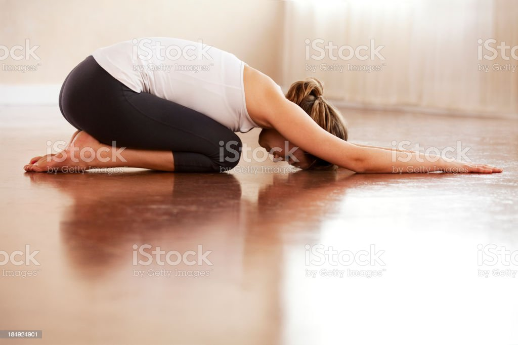 Relaxed woman doing yoga stock photo