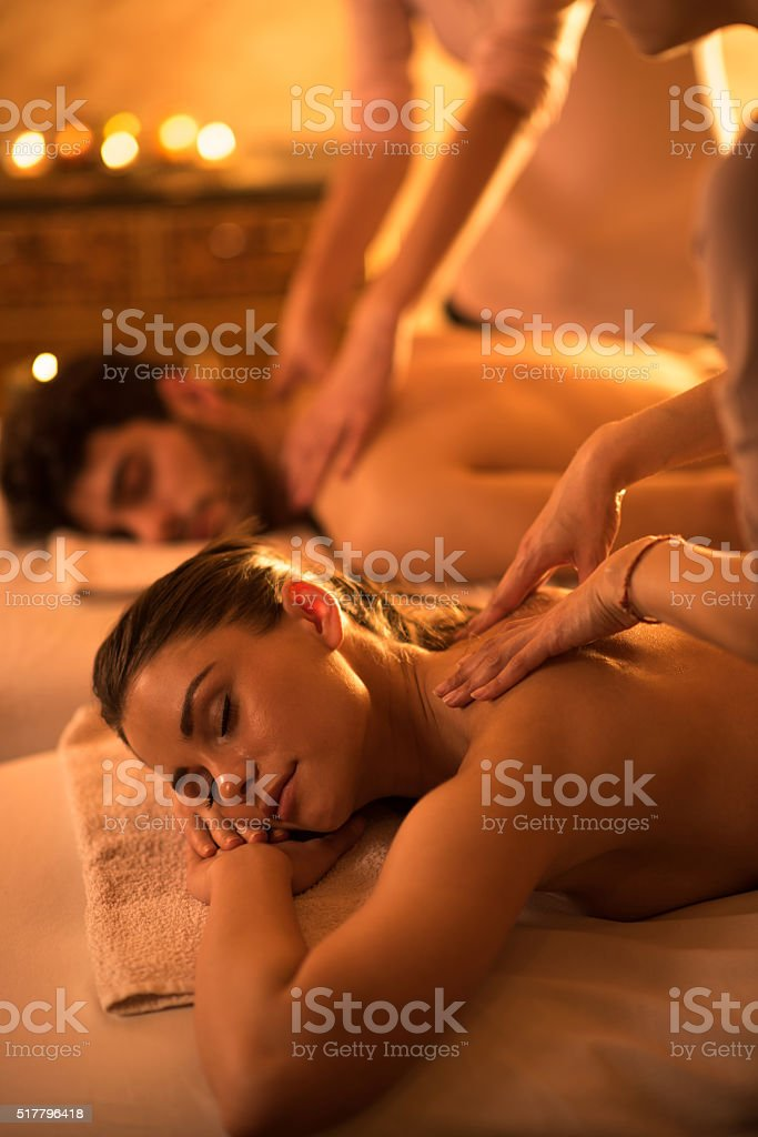 Relaxed woman enjoying in back massage at the spa. stock photo