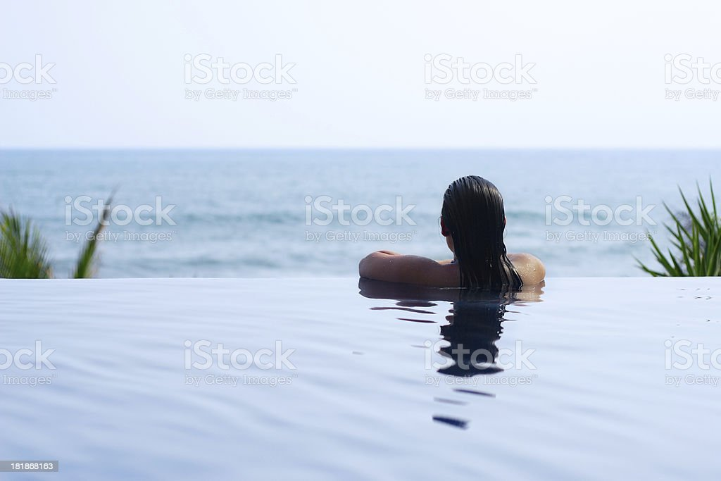 Relaxed Woman in The Pool royalty-free stock photo