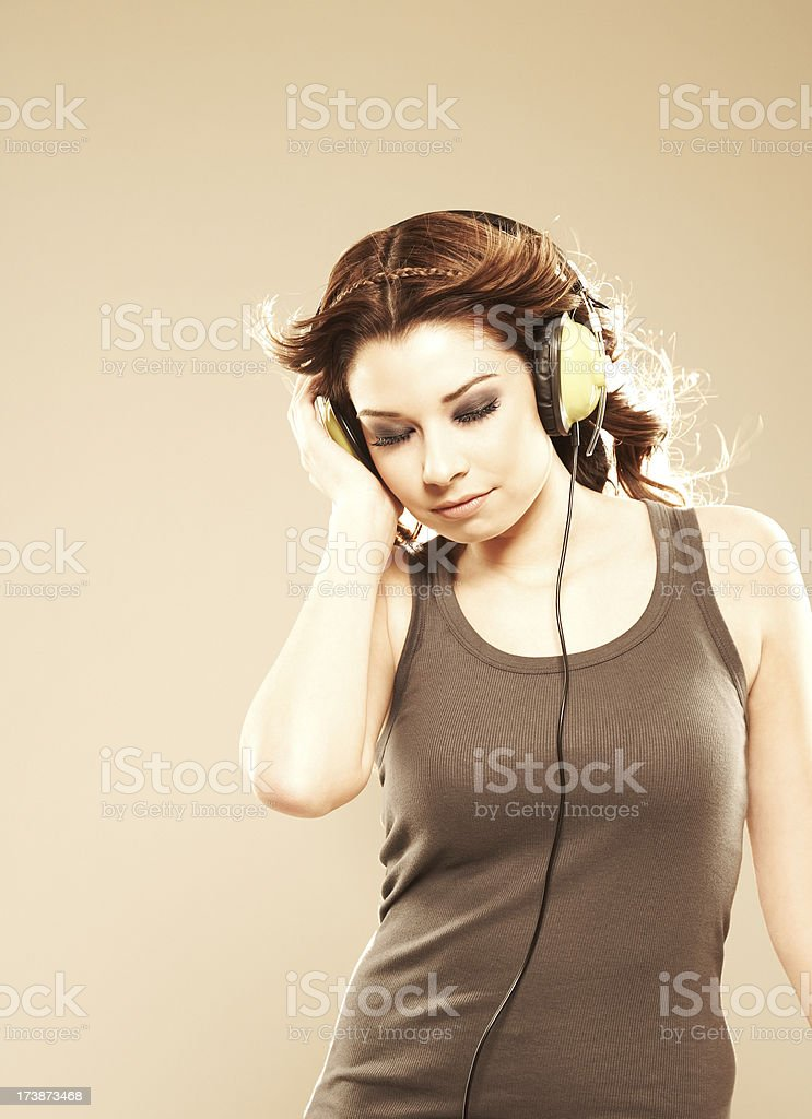 Relaxed woman listening to music with headphones royalty-free stock photo