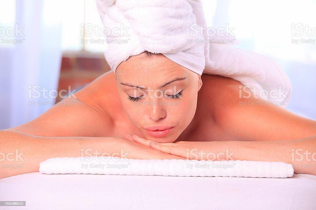 Relaxed woman on massage table royalty-free stock photo