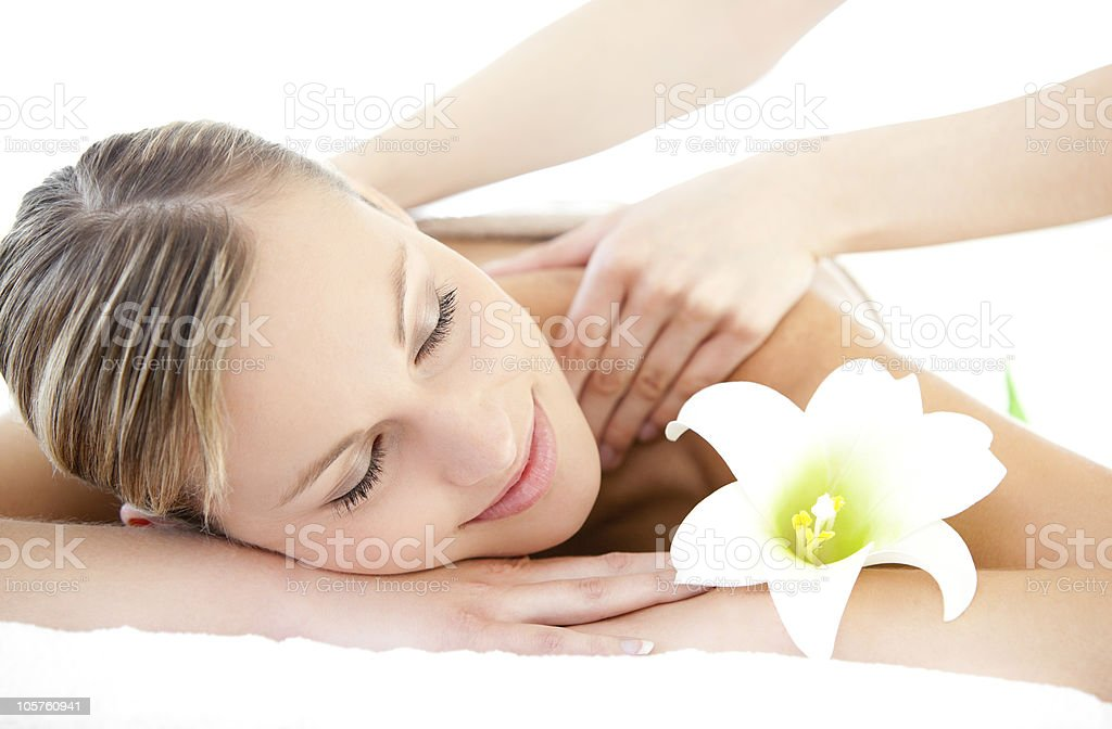 Relaxed woman receiving a back massage stock photo