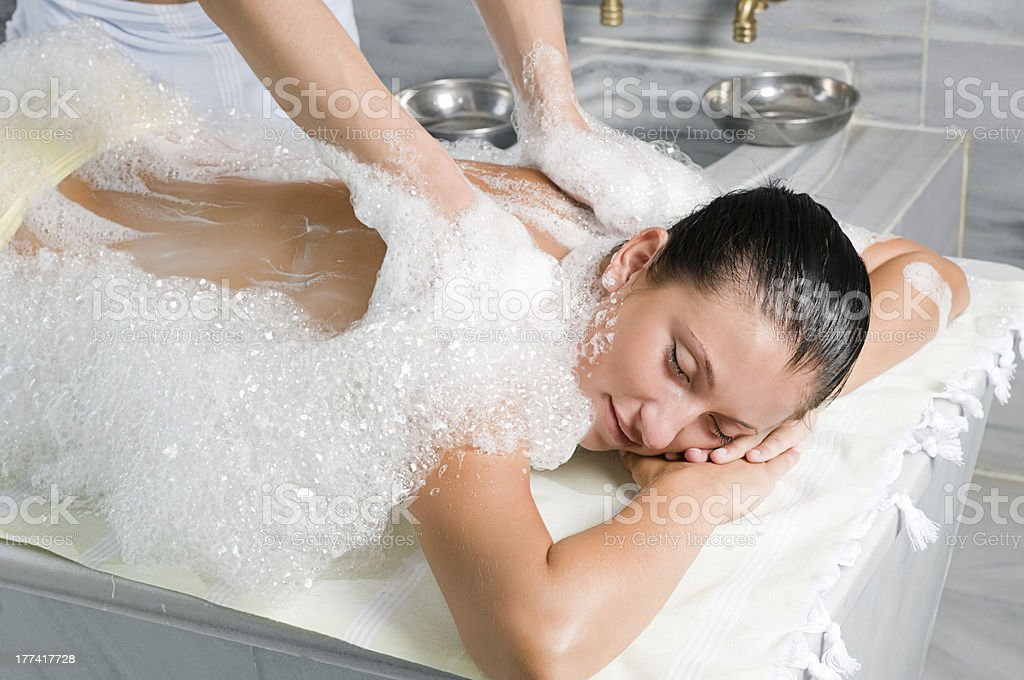 A relaxed woman receiving a Turkish bath stock photo