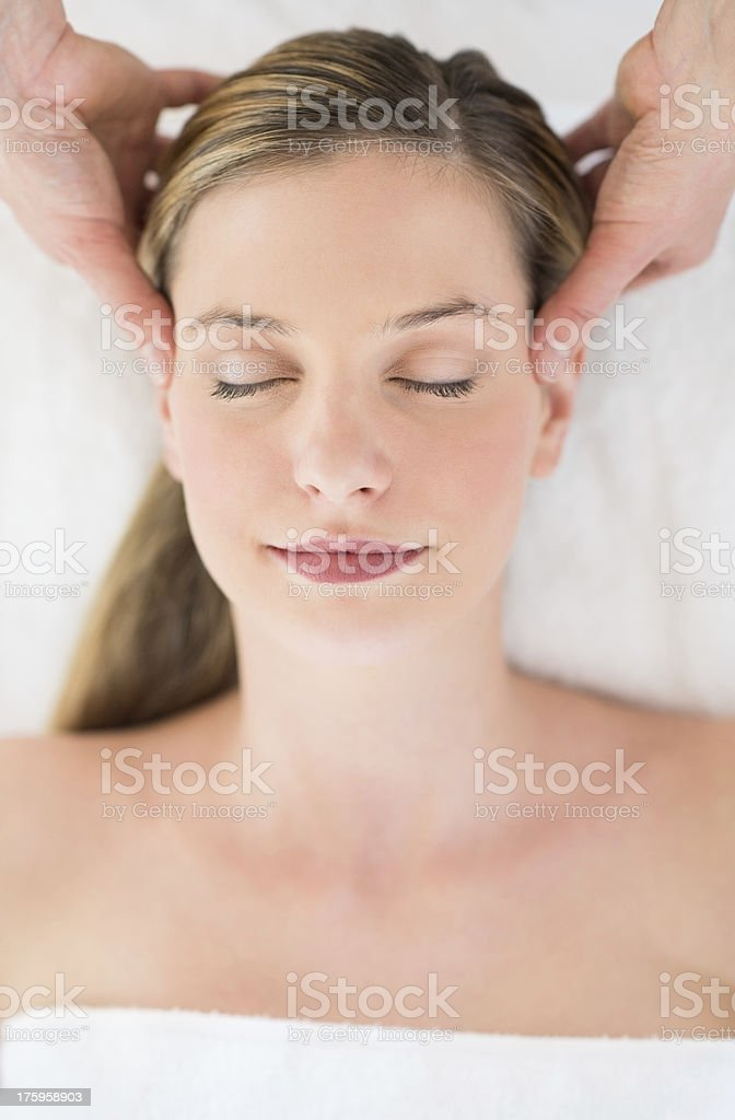 Relaxed Woman Receiving Head Massage At Health Spa royalty-free stock photo