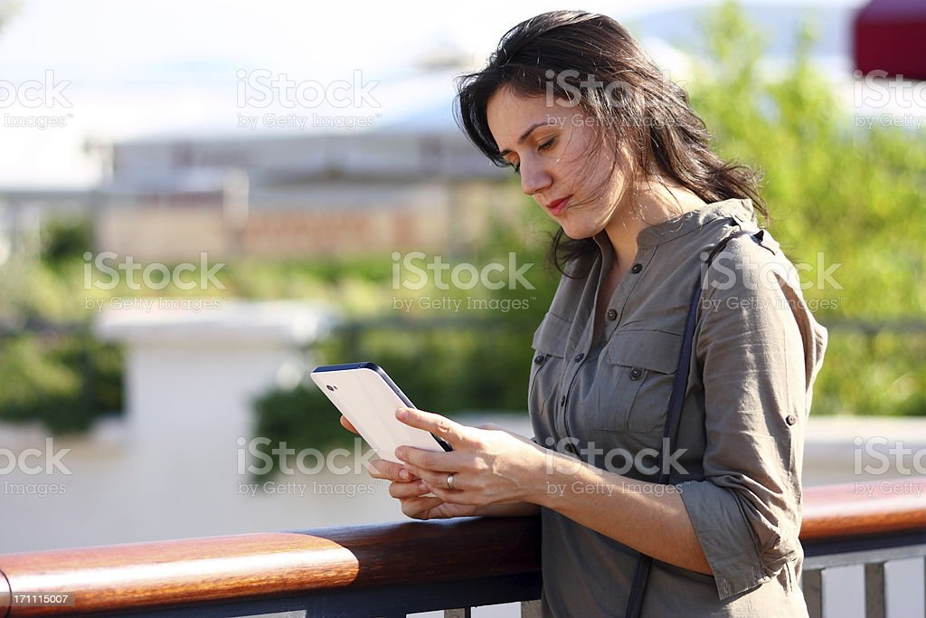 Relaxed woman using digital tablet royalty-free stock photo