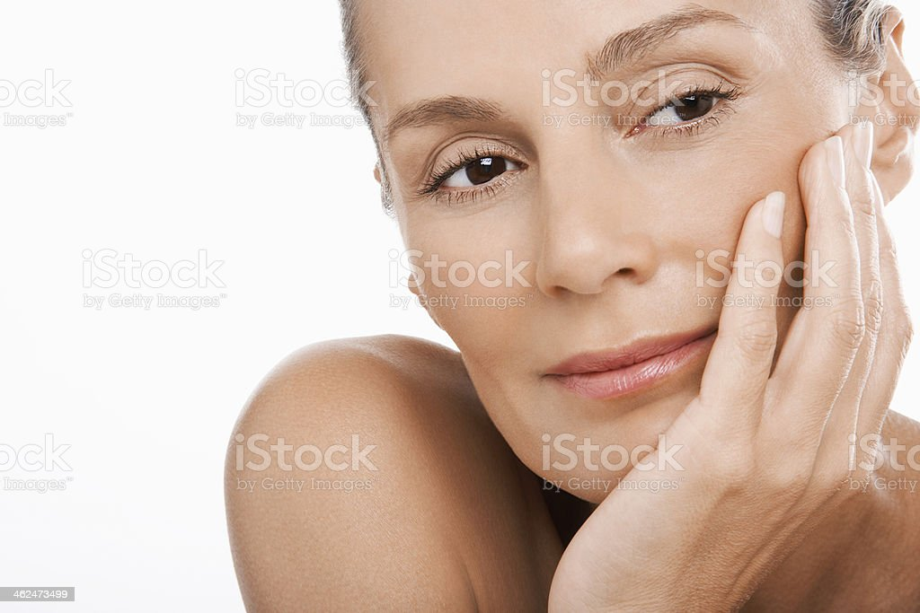 Relaxed Woman With Hand On Chin stock photo
