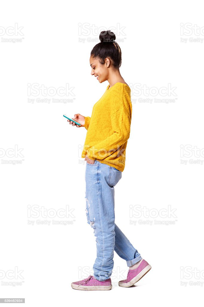 Relaxed young african woman using mobile phone stock photo