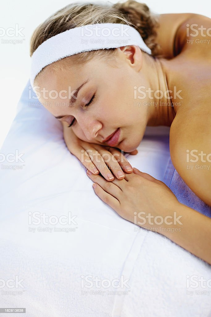 Relaxed young lady getting ready for a spa treatment royalty-free stock photo