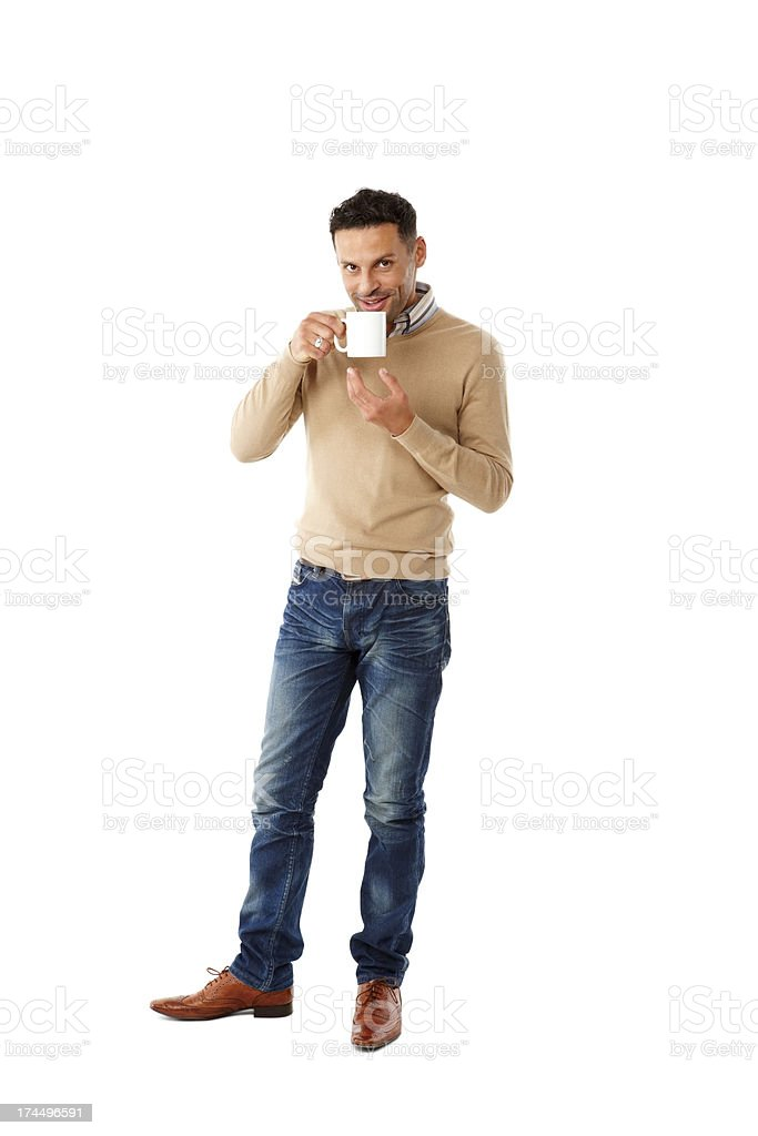 Relaxed young man drinking coffee stock photo