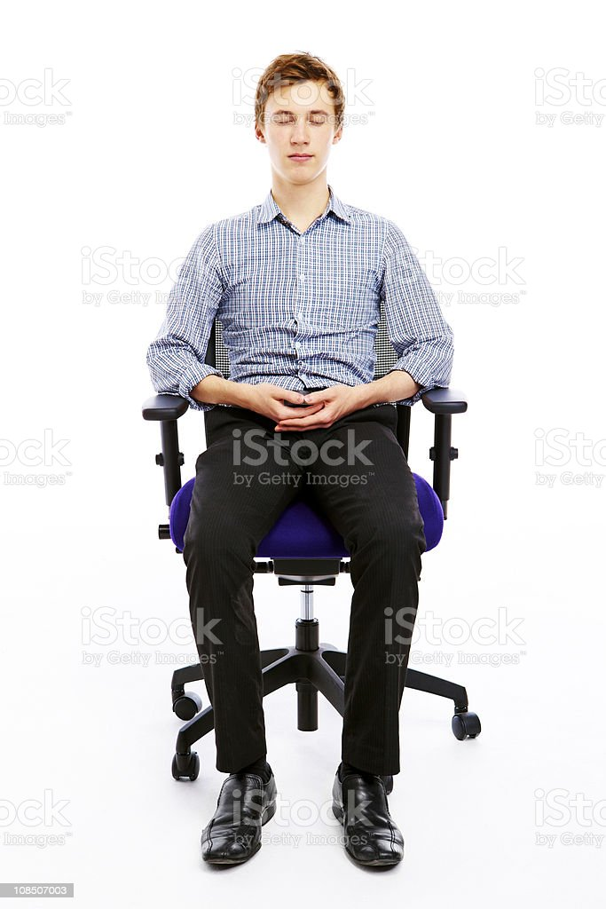 relaxed young man meditation in office chair royalty-free stock photo
